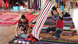 Ethnic costumes bring villagers extra income