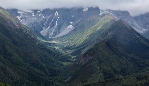 Melting snow seen on Baima Snow Mountain in summer